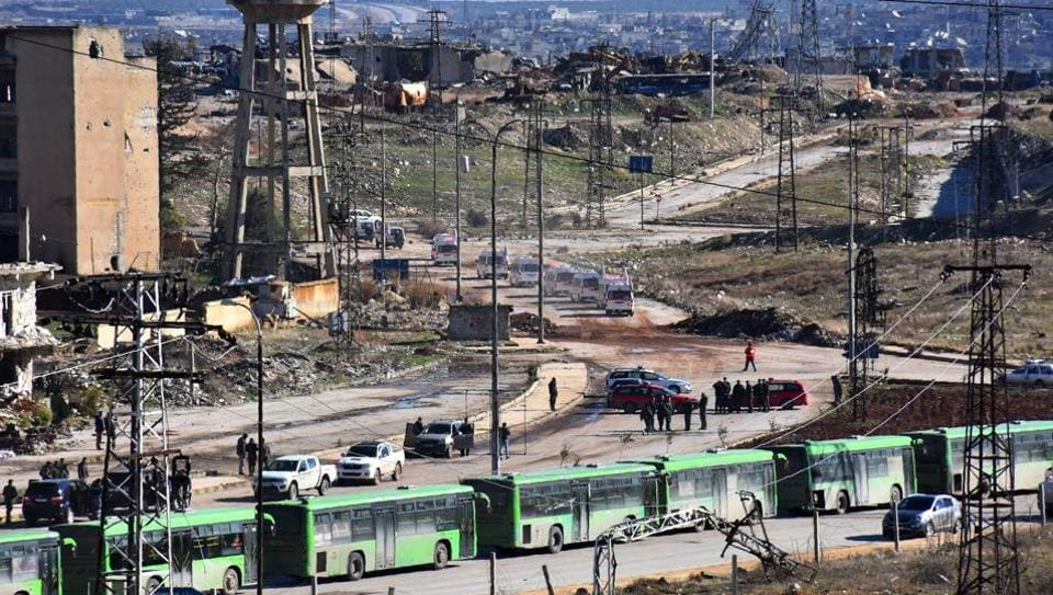 Buses are seen during an evacuation operation of rebel fighters and their families from rebel-held neighbourhoods in the embattled city of Aleppo on December 15, 2016. The rebel withdrawal will pave the way for President Bashar al-Assad's forces to reclaim complete control of Syria's second city.