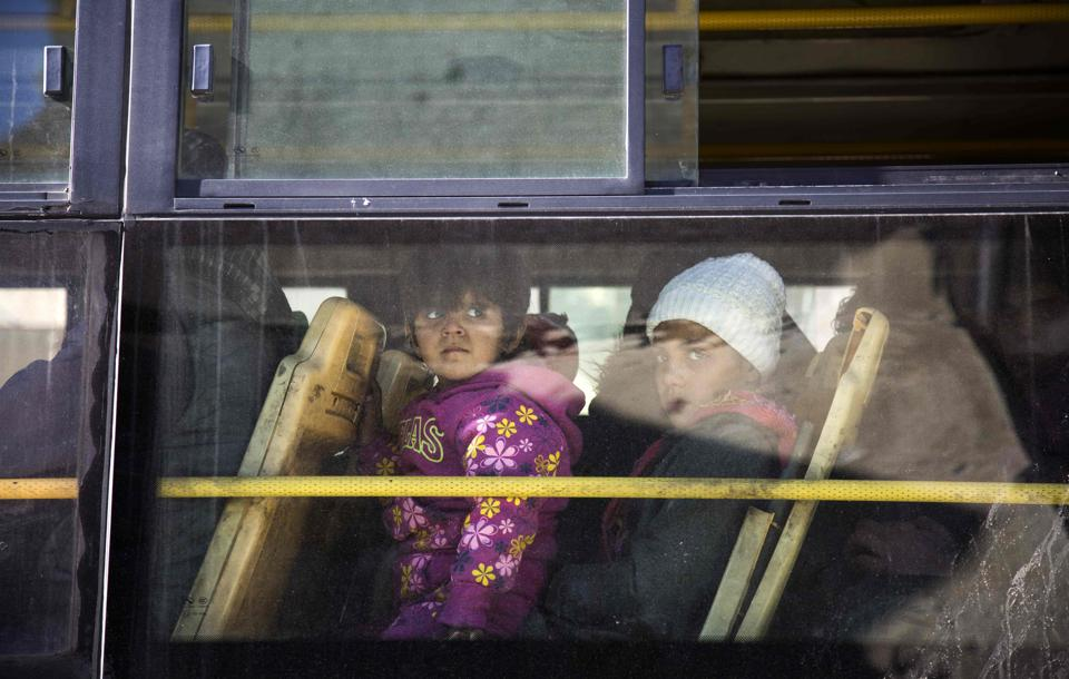 Children on a bus during an evacuation operation of rebel fighters and their families from rebel-held neighbourhoods in the embattled city of Aleppo. (AFP)