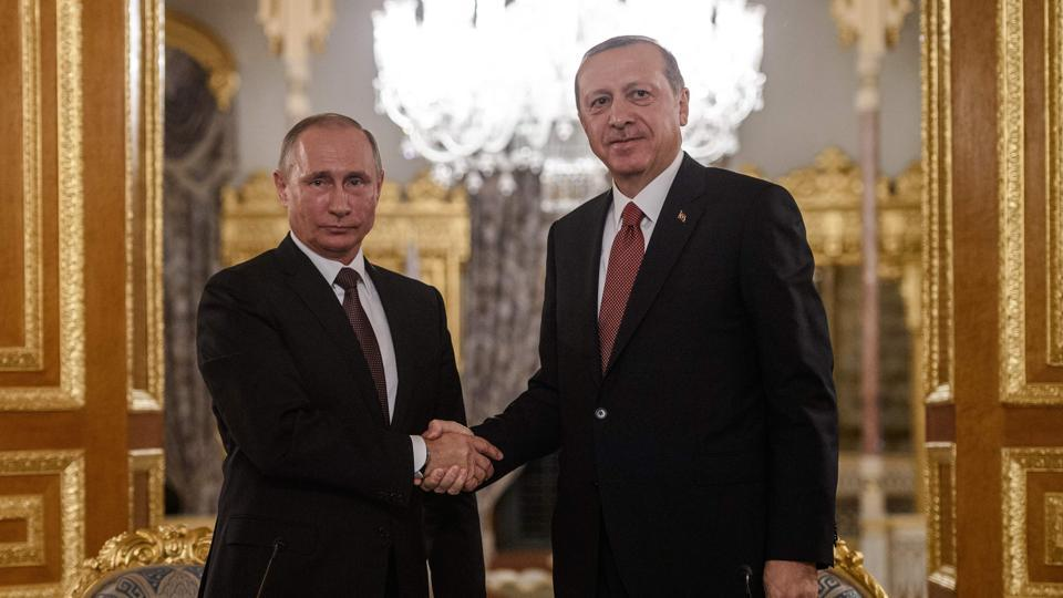 Russian President Vladimir Putin (L) shakes hands with Turkish President Recep Tayyip Erdogan in Istanbul in October 2016.