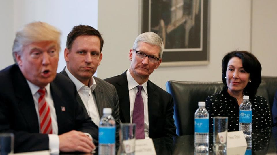 US President-elect Donald Trump speaks as (2nd L to R) PayPal co-founder and Facebook board member Peter Thiel, Apple Inc CEO Tim Cook and Oracle CEO Safra Catz look on during a meeting with technology leaders at Trump Tower in New York.