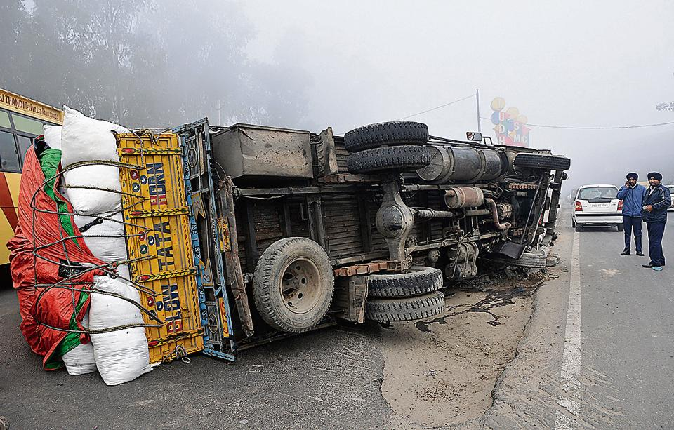 explosives-laden truck overturns