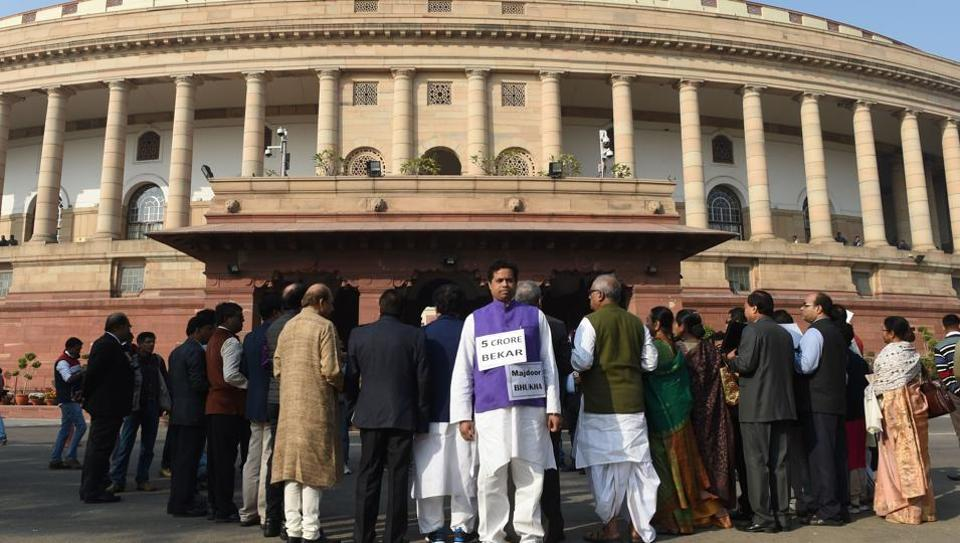 TMC leaders hold placards during a protest against demonetisation at the Parliament House in New Delhi.