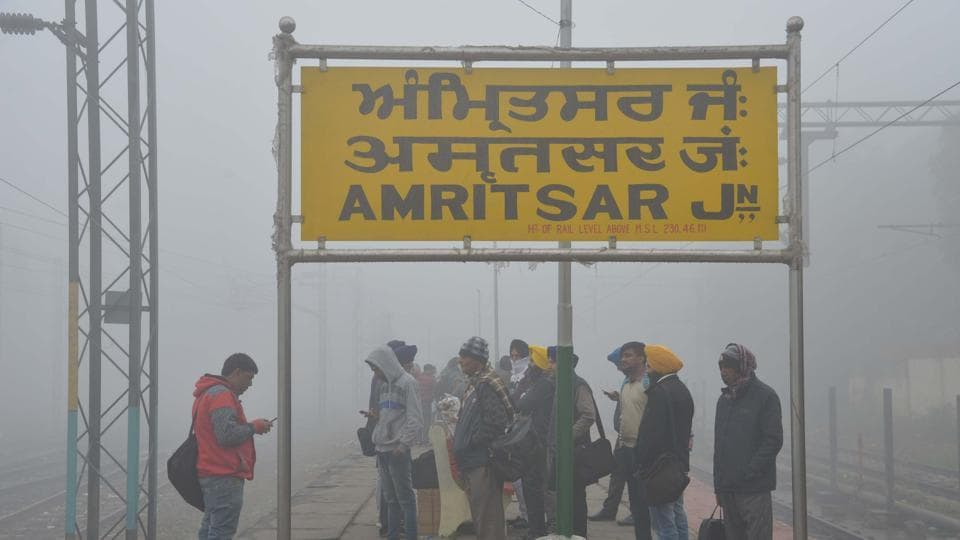 Indian passengers wait for a train at the railway station in Amritsar on December 14.