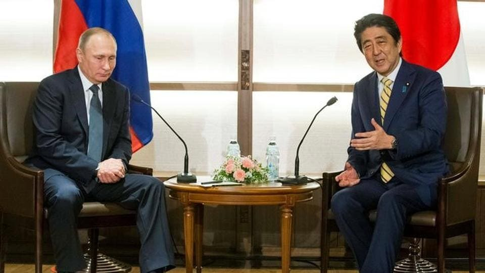 Japanese Prime Minister Shinzo Abe gestures while speaking to Russian President Vladimir Putin during their meeting at a hot springs resort in Nagato, Japan.