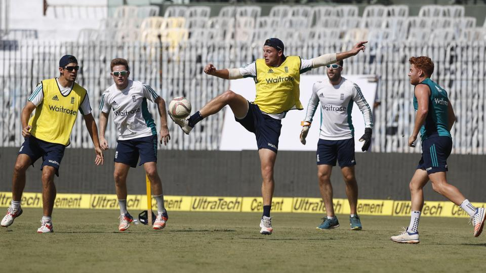 England's Jos Buttler, center, plays football with other cricketers to warm up during a practice session. (AP)