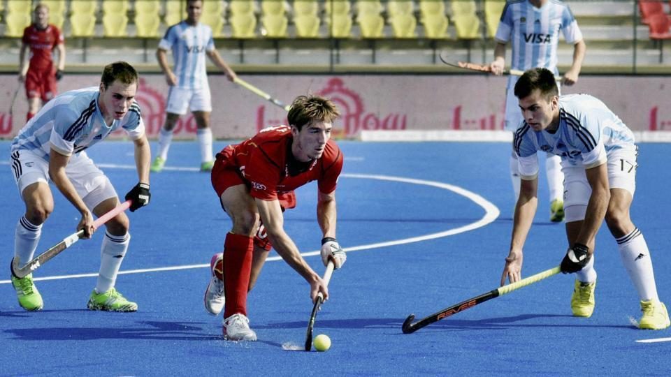 Belgium (red) and Argentina players vie for the ball during the Hockey Junior World Cup quarter final match.