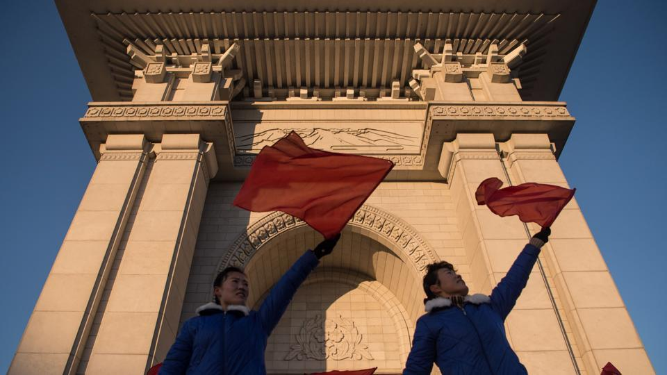 A propaganda troupe perform before the Arch of Triumph on the last day of the 200-day campaign in Pyongyang on December 15.
