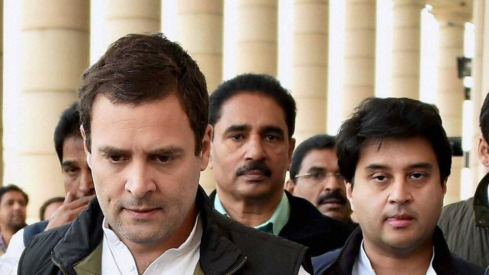 Congress leader Rahul Gandhi and his party colleague Jyotiraditya Scindia walk to address a press conference at Parliament on Wednesday.