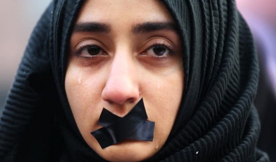 A Turkish student cries during a protest to show solidarity with the trapped citizens of Aleppo, Syria.