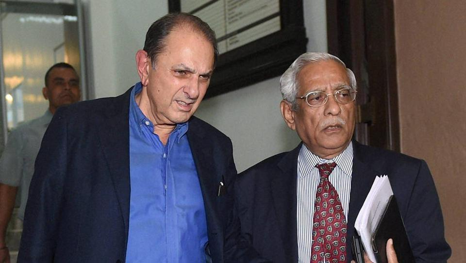 Tata Steel independent director Nusli Wadia and Tata Motors director Subodh Bhargava leave Bombay House after a Tata Motors board meeting in Mumbai.