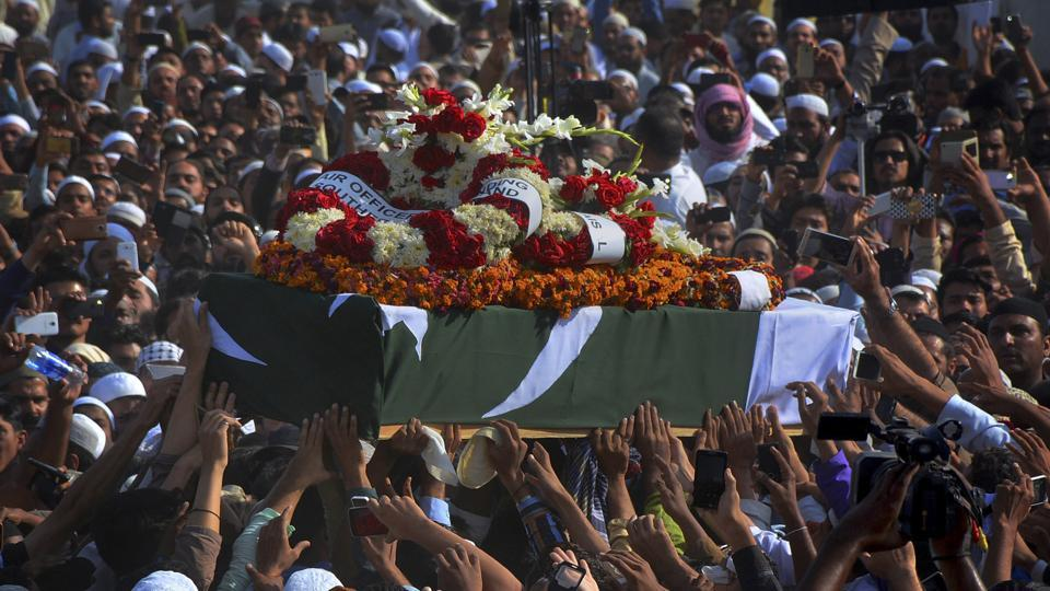 People carry the coffin of Junaid Jamshed, a popular pop singer turned Islamic preacher, during his funeral in Karachi, Pakistan, on December 15, 2016.