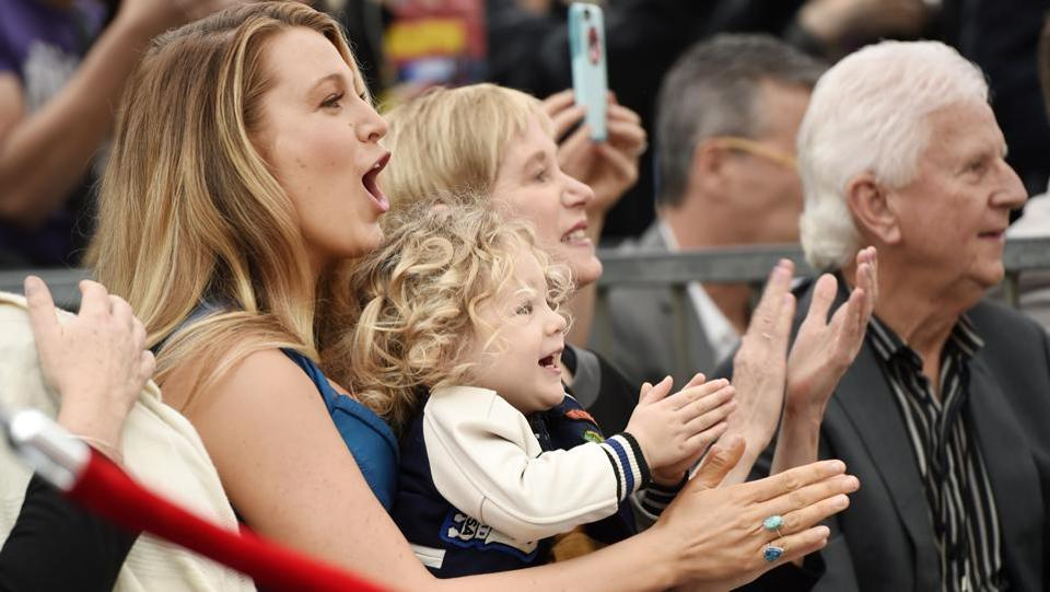 Applauding with daughter James. (Chris Pizzello/Invision/AP)