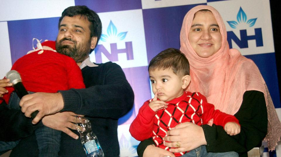 Zeenia (L), two and half year old girl from Sahiwal in Pakistan who underwent successful Bone Marrow Transplant at Narayana Health City hospital in Bengaluru on Friday. Donor of bone marrow is her 8 months old brother Ryan (R) said to be the youngest donor with her father Zia Ulla (L).