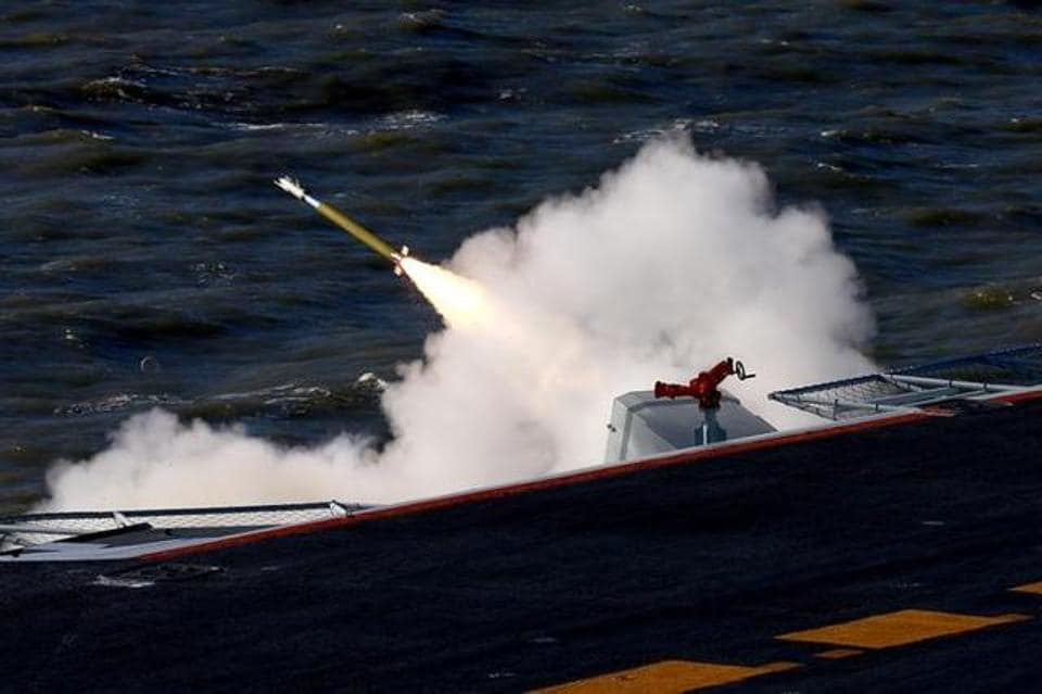 A live-fire drill using an aircraft carrier is seen carried out in the Bohai sea, China on December 14.