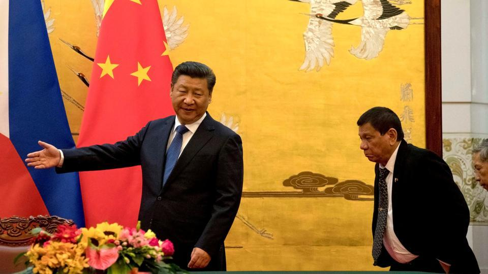 Philippine President Rodrigo Duterte (R) is shown the way by Chinese President Xi Jinping before a signing ceremony held in Beijing, China, in October 2016.