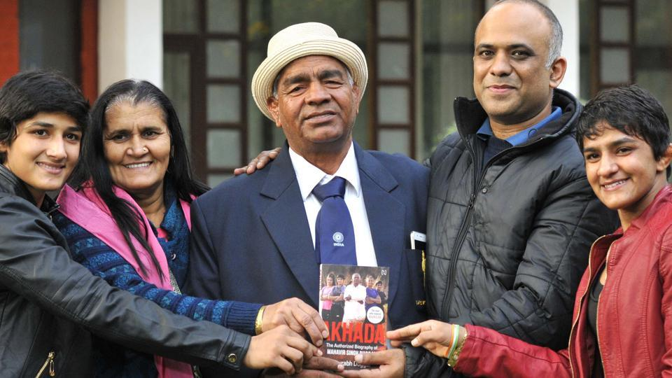 (From left) Sangeeta Phogat, Daya Kaur, Mahavir Phogat, author Saurabh Duggal and Ritu Phogat during the release of Mahavir Phogat's autobiography at Chandigarh Press Club on Thursday.
