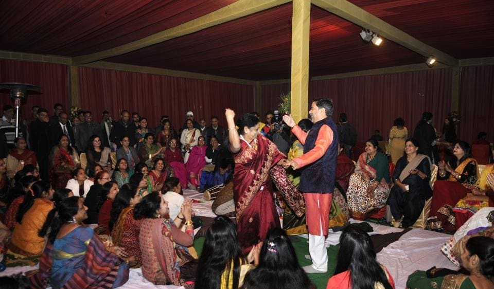 Families and relatives of the 72 couples take part in a sangeet ceremony in Noida.