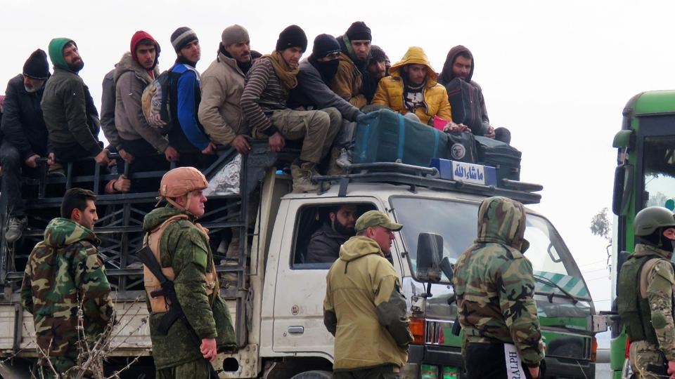 Civilians and fighters being evacuated from a rebel-held area of Aleppo.