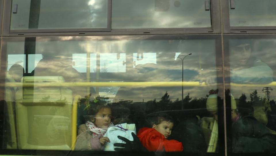 Evacuees from rebel-held eastern Aleppo arrive by bus to an area on the western edge of Aleppo city which is held by insurgents, in Syria December 16, 2016.