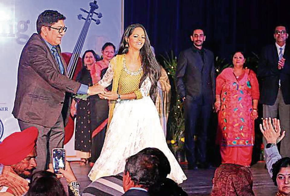 Acid attack victim Laxmi walking the ramp with cancer survivors during a fashion show in Ludhiana on Friday.