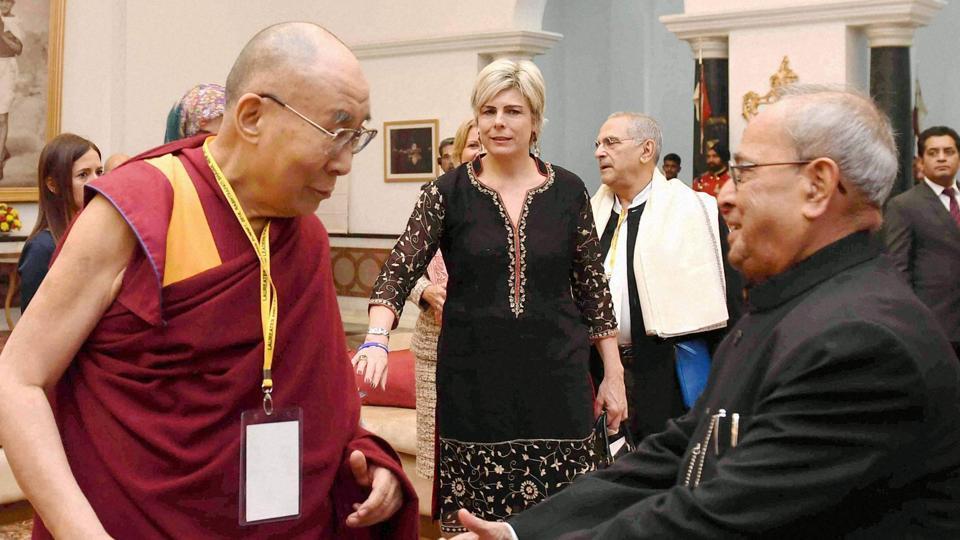 President Pranab Mukherjee with Tibetan spiritual leader, the Dalai Lama during the inaugural session of Laureates & Leaders Summit for Children at President House in New Delhi.