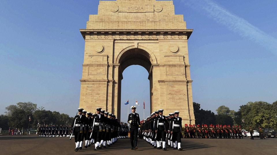 Soldiers pay homage to martyrs at 'Amar Jawan Jyoti' at India Gate on 'Vijay Diwas' in New Delhi on Friday.  (PTI)