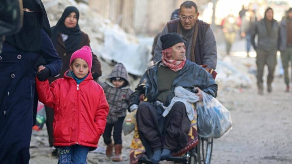 People walk as they gather to be evacuated from a rebel-held sector of eastern Aleppo, Syria December 15, 2016.