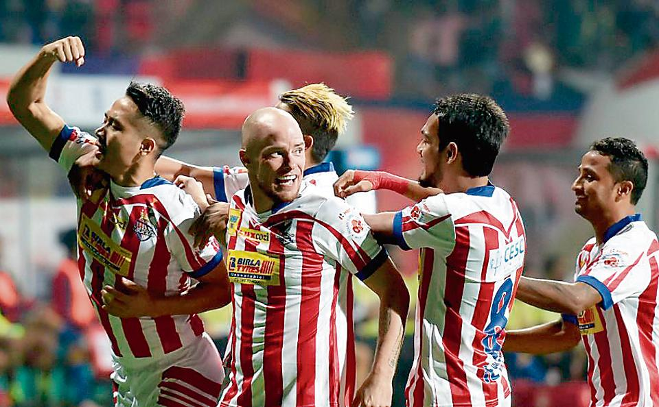 Atletico de Kolkata midfielder Lalrindika Ralte (L) celebrates with teammates after scoring a goal against Mumbai City FC during their Indian Super League semifinal match. ATK will clash with Kerala Blasters in ISL 2016 final on Sunday.