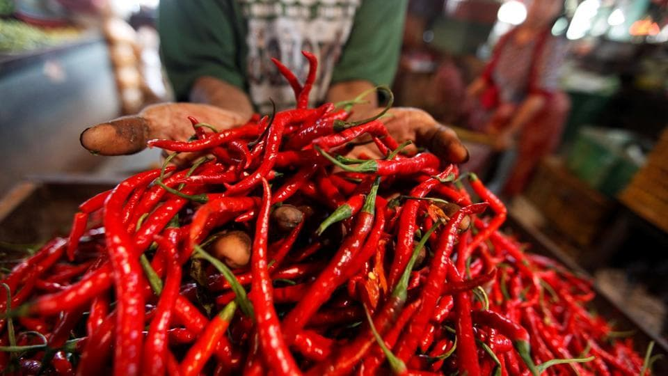 A trader displays chilis for sale at a traditional market in Jakarta, Indonesia, on December 16, 2016.