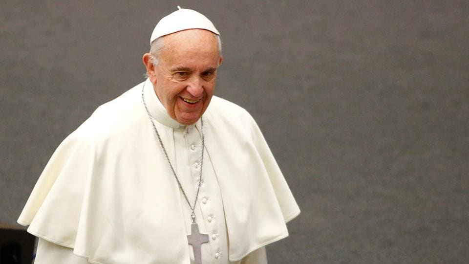 Pope Francis arrives to lead his Wednesday general audience in Paul VI hall at the Vatican on December 14.