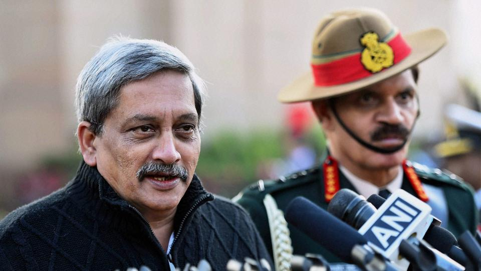Defence minister Manohar Parrikar speaks to media after paying homage to the martyrs at Amar Jawan Jyoti on the occasion of 'Vijay Diwas' in New Delhi.