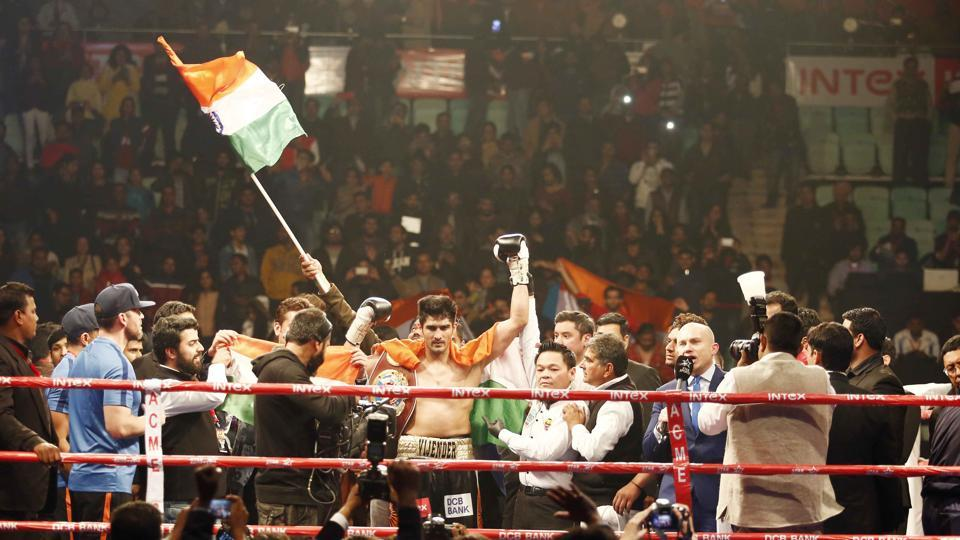 Baba Ramdev led a group of celebrities and stormed into the ring to hug and congratulate Vijender Singh on his victory.