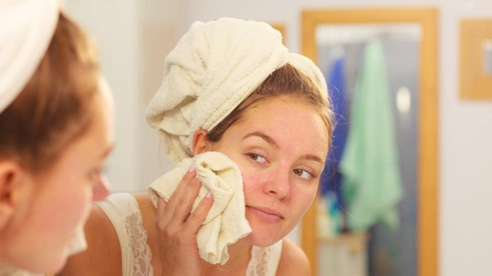 Wash your face once or twice a day with a mild cleanser and lukewarm water, especially before going to bed to remove makeup and dirt. Avoid scrubbing or using harsh abrasive products. (Shutterstock)