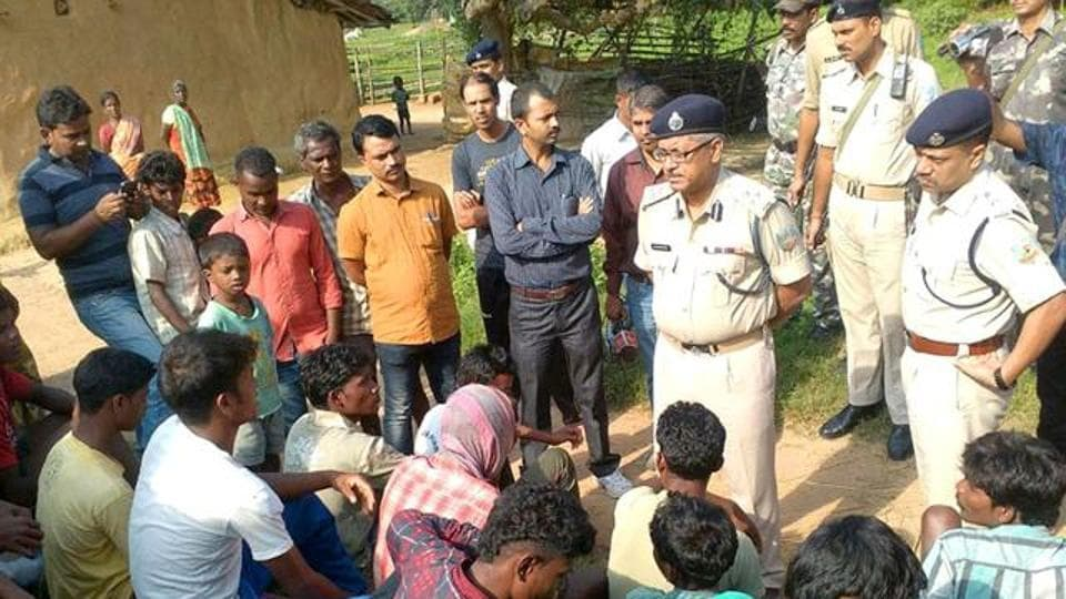 In this photo from August 2016, police talk to residents of Kanja village in Jharkhand after five women were killed over accusations of  practising witchcraft. Crimes against women in the state have been increasing, with rape or being labelled a witch being the major reasons.