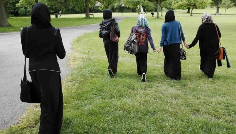 Muslim woman Hijab pulled