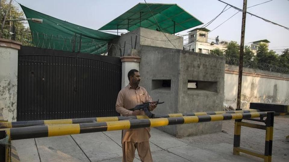 File photo of a security guard from the Ahmadi community outside the Ahmadi's Batul Noor mosque in Lahore in December 2013.