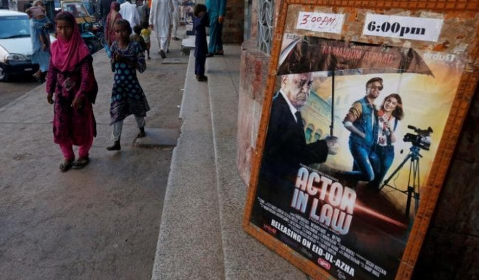 An advertising poster for an Indian film is seen outside a movie theatre in Karachi in September 2016.