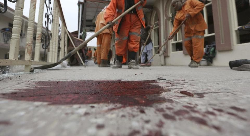 Afghan Municipality workers sweep Baqir-ul Ulom mosque after a suicide attack, in Kabul, Afghanistan on Nov 21.