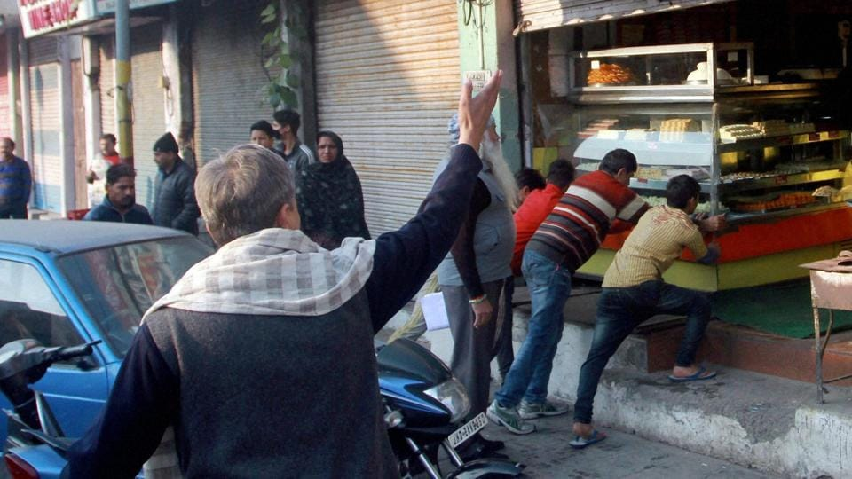 Jammu and Kashmir National Panthers Party forcefully closing shops during a bandh call on Saturday to protest against compensation announced for the family of militant Burhan Wani.