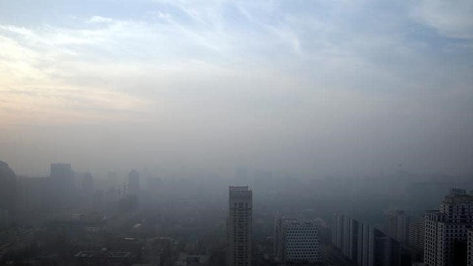 Buildings are seen in smog on a polluted day as a red alert for air pollution is issued in Beijing.