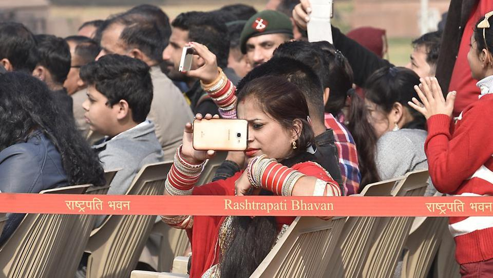 An audience takes pictures during the  Change of Guard Ceremony.  (Raj K Raj/HT PHOTO)
