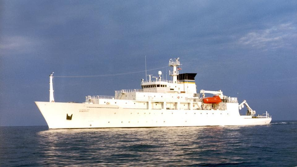 In this undated photo released by the US Navy Visual News Service, the USNS Bowditch, a T-AGS 60 Class Oceanographic Survey Ship, sails in open water. The USNS Bowditch, a civilian US Navy oceanographic survey ship, was recovering two drones on Thursday when a Chinese navy ship approached and sent out a small boat that took one of the drones.