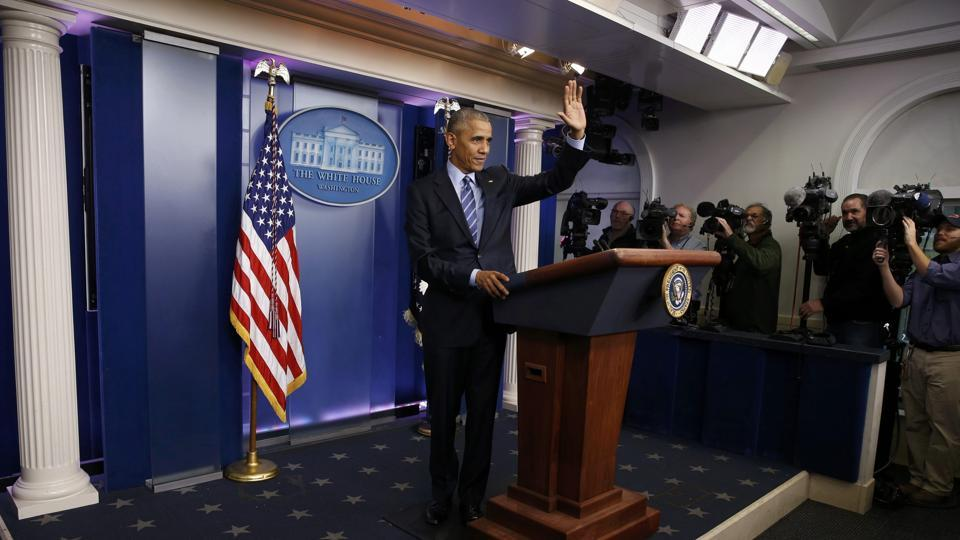 US President Barack Obama waves as he leaves the podium after speaking to journalists during his last news conference of the year at the White House in Washington on December 16.