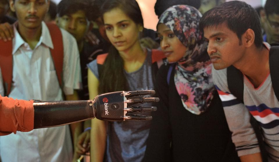 Participants at the IIT-BTech Fest examine a biometric hand  on Friday.