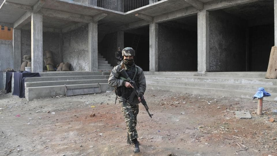 A securityman at the site of an attack in Pampore that killed three soldiers on the outskirts of Srinagar on Saturday.