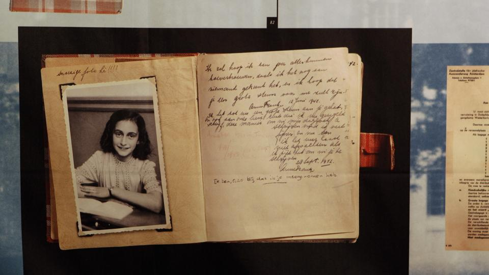 A photo of Anne Frank at the opening of the exhibition:
