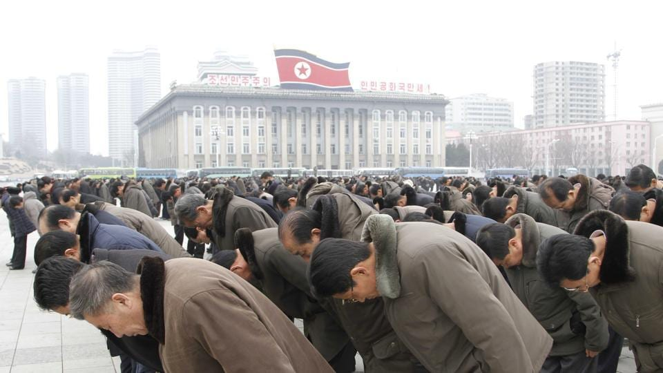 People bow to portraits of the late leaders, Kim Il Sung and Kim Jong Il, at the Kim Il Sung Square in Pyongyang, North Korea, Saturday, Dec. 17, 2016, to mark the fifth anniversary of Kim Jong Il's death. It's been five years since North Korean leader Kim Jong Un took power following the death of his father, Kim Jong Il, whose demise was observed at monuments and on city center plazas across the nation Saturday. (AP Photo/Kim Kwang Hyon)