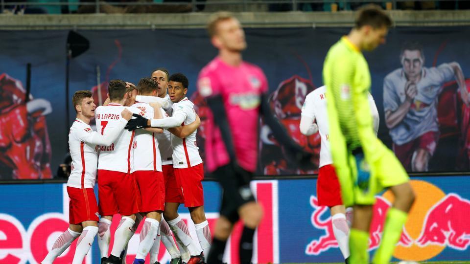 Leipzig's Willi Orban celebrates after scoring against Hertha Berlin.