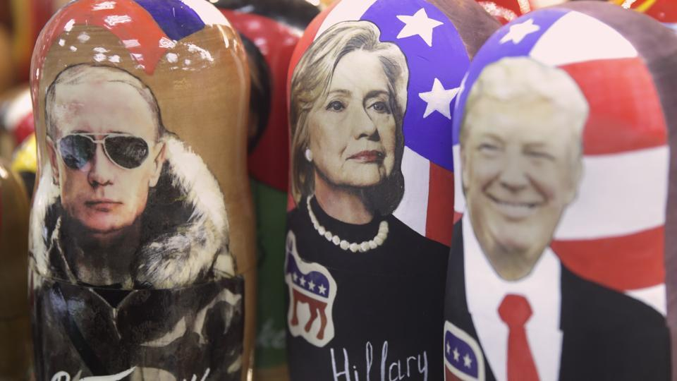 Traditional Russian wooden dolls called Matreska depicting Russian president Vladimir Putin, Hillary Clinton and Donald Trump are displayed in a shop in Moscow, Russia.