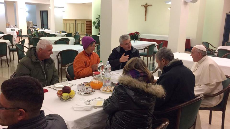 Pope Francis, right, flanked at right by Mons. Konrad Krajewski, celebrates his 80th birthday sharing a breakfast with homeless people before celebrating Mass with cardinals at the Vatican, Saturday Dec. 17, 2016.